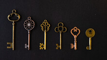 Many Different Old Keys From Different Locks, In Order In A Line, Flat Lay.
