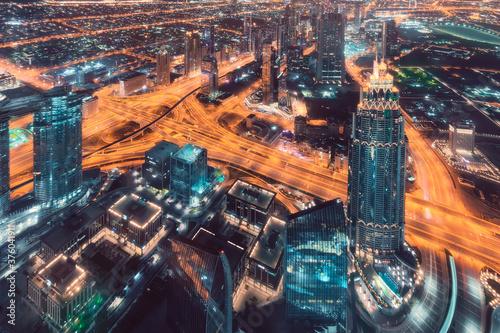 Fototapeta Futuristic skyline of downtown in Dubai city at night obraz na płótnie