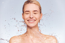 Photo Of  Young  Woman With Clean Skin And Splash Of Water. Portrait Of Smiling Woman With Drops Of Water Around Her Face. Spa Treatment. Girl Washing Her Body With Water. Water And Body.