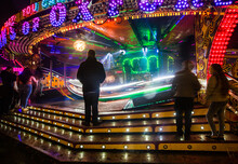 People Watching The 'Waltzer' Fairground Ride At Witney Feast.