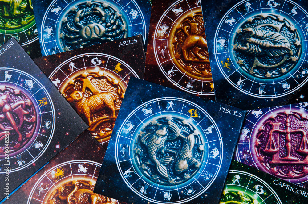 Fototapeta zodiac signs and symbols and horoscope like astrology concept and full frame astrological background