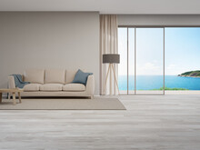 Beige Sofa Near Blank Wall On Empty Wooden Floor Of Large Living Room In Modern House Or Luxury Hotel. Cozy Home Interior 3d Rendering With Beach And Sea View.