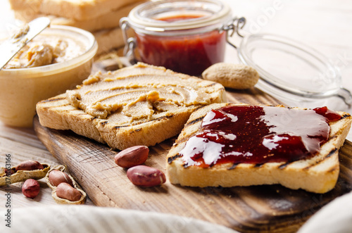 Vászonkép Low angle view at peanut butter and jam  sandwiches on cutting board with toasts aside
