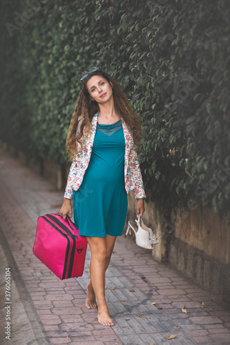 young woman with shopping bags #376065104