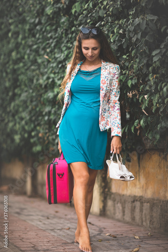 young woman with shopping bags #376065108