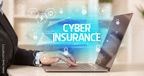 Fototapety, obrazy: CYBER INSURANCE inscription on laptop, internet security and data protection concept, blockchain and cybersecurity