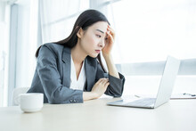 Business Woman Sad And Worried Working With A Laptop In An Office,hard Work Concept