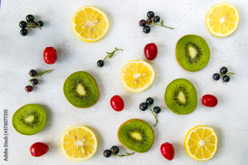Currant, Cornus and dogberry, lemon and kiwi high angle view Tableau sur Toile