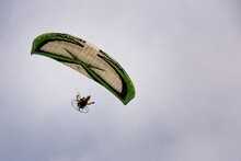 Motorized Paraglider Flying Th...