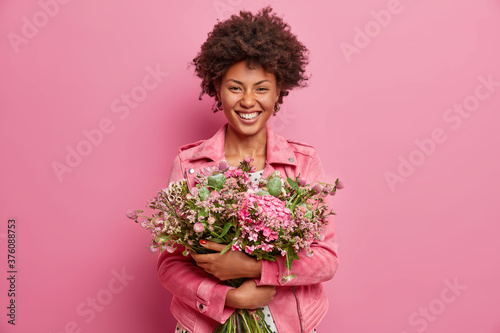 Canvas Print Horizontal shot of pretty African American woman expresses sincere emotions, emb