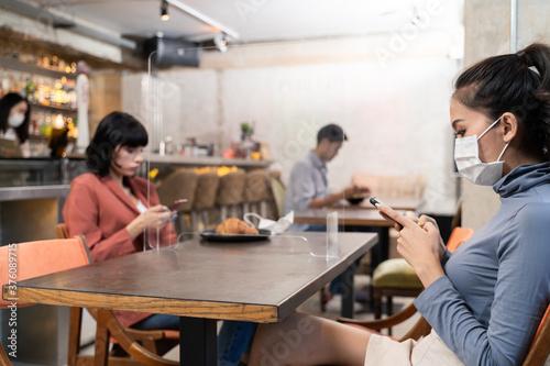 Fototapeta New normal customer dine in restaurant