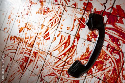 Obraz na plátně hung up phone blood stains on white tiles
