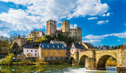 runkel castle in germany with a stone bridge in the foreground