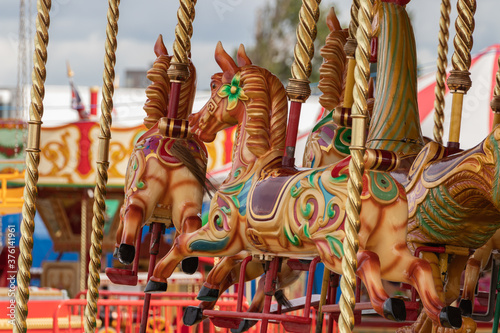the painted horses on a traditional english carousel ride Tapéta, Fotótapéta