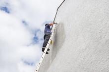 Man Up A High Ladder Painting ...