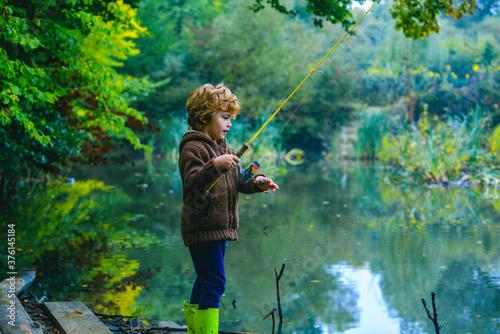 Fotografie, Obraz Cute child little boy fishing. Happy kids weekend concept.