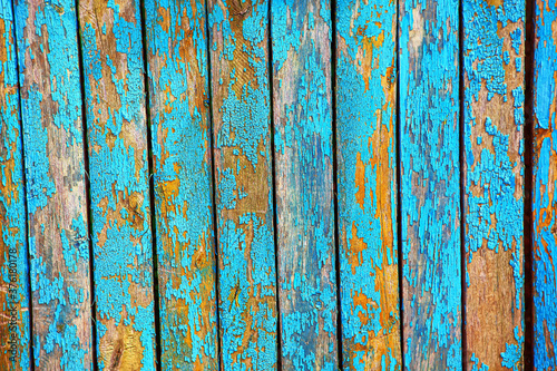 Obraz na plátně Old paint with cracks on the fence . Old wooden planks texture