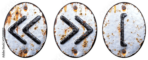 Fotografie, Obraz Set of symbols left and right pointing double angle quotation mark, left square bracket made of forged metal on the background fragment of a metal surface with cracked rust