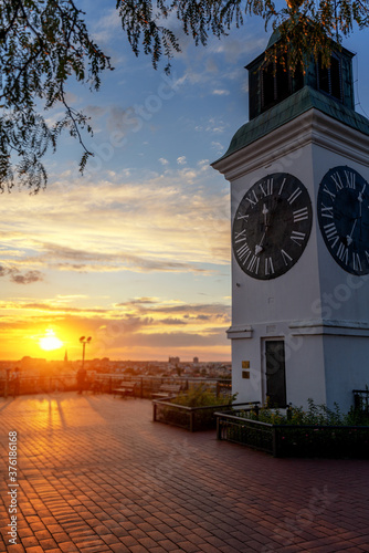 Tablou Canvas Clock tower in the Petrovaradin fortress at sunset, travel Balkan countries