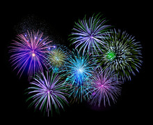 Explosive Colorful Green, Blue And Purple Fireworks Display In The Night Sky