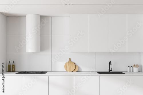 Fototapeta White kitchen interior with cabinets, close up obraz