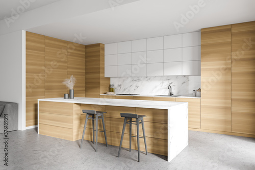White and wooden kitchen with bar and sofa