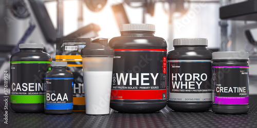 Fotografia Sports nutrition supplements and chemistry for bodybuilding in gym