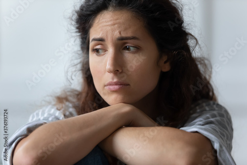 Photo Close up sad woman sit indoor feels offended by beloved man