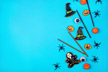 Halloween Flat Lay Composition With Pumpkins, Drink Straws, Spiders, Confetti, Treat.