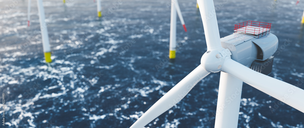 Fototapeta Offshore wind power and energy farm with many wind turbines on the ocean