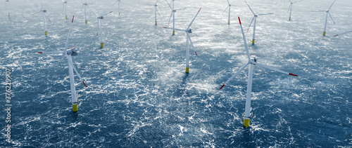 Offshore wind power and energy farm with many wind turbines on the ocean #376229907
