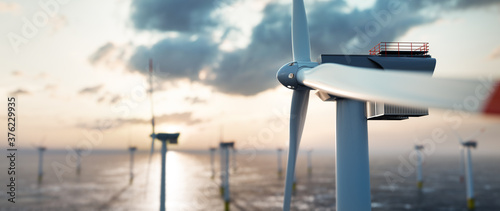 Offshore wind power and energy farm with many wind turbines on the ocean #376229935