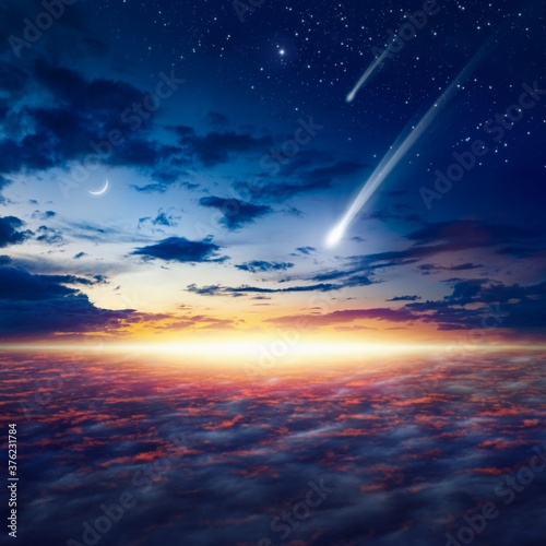 Amazing heavenly image with beautiful glowing sunset, shooting stars, rising cre Canvas