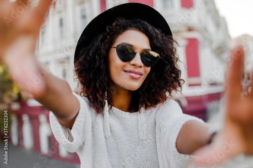 Beautiful black woman with stylish Afro hairs making self portrait Canvas Print