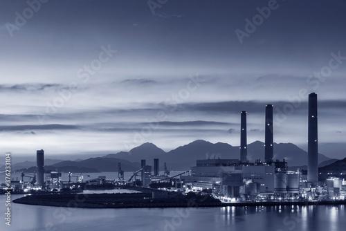 Fotografie, Tablou Power plant in Hong Kong city at dusk