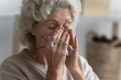 canvas print picture - Close up exhausted mature woman suffering from eye strain, holding glasses, touching massaging nose bridge, tired stressed middle aged female feeling unwell, fatigue, vision health problem