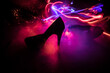 Silhouette of a high heel women shoes at dark. Women power or women domination concept.