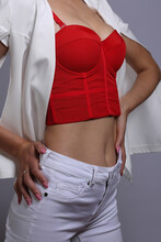 Red Bustier And White Jeans On...