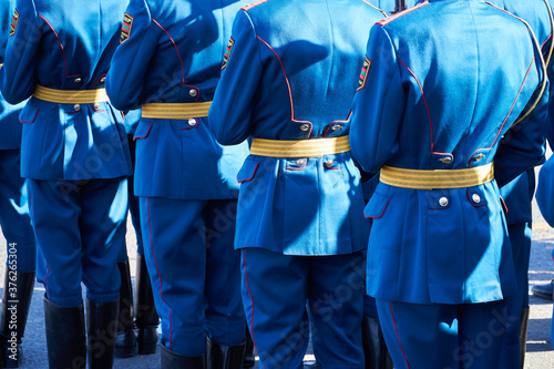 Fototapeta military parade in a city, soldiers in full dress uniforms ordered in parade for