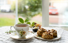 Traditional Homemade British Cheese Scones With Hot Cup Of Tea, Baked Scones English Buns With Bright Light Morning Or Cozy Scene Of Relaxing In Afternoon Break,Tea Time With Hot Coffee In Tea Room