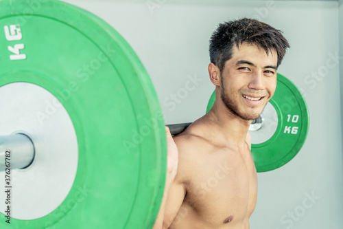 athlete young man working out Wallpaper Mural