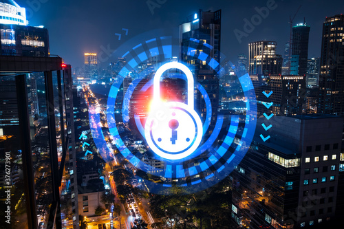 Fototapeta Glowing Padlock hologram, night panoramic city view of Bangkok, Asia. The concept of cyber security to protect companies. Double exposure. obraz na płótnie