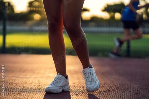 Fotografie, Obraz Piernes de mujer  en pista de atletismo