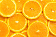 Full frame of fresh orange fruit slices pattern background, close up, high angle view