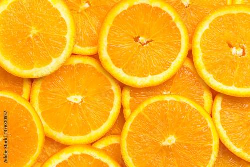 Obraz Full frame of fresh orange fruit slices pattern background, close up, high angle view - fototapety do salonu