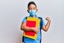 Little Boy Hispanic Kid Wearing Medical Mask Going To School Screaming Proud, Celebrating Victory And Success Very Excited With Raised Arm