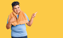 Little Boy Kid Wearing Sportswear And Towel Smiling Happy Pointing With Hand And Finger To The Side