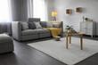 Elegant living room with comfortable sofa near window. Interior design