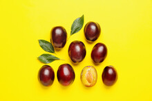 Tasty Sweet Plums On Color Bac...