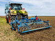 tractor in the field with disc harrow attached